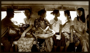 People riding on a commuter train in Yangon, Myanmar  2012